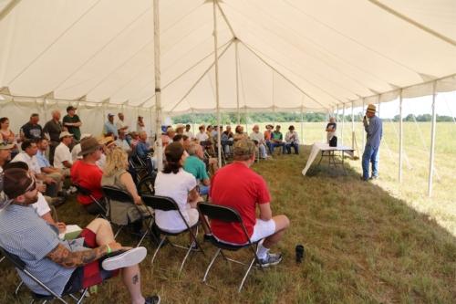 Noah Brown speaking at prairie dedication.