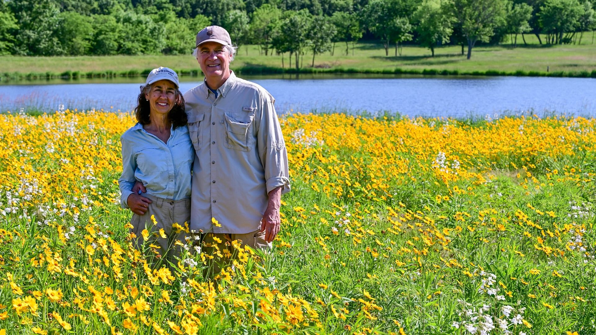 Susan and Dennis in their reconstructed prairie planted from seed, in its third year.Credit: Rick Kraft
