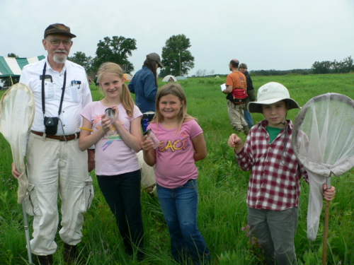 Kids holding nets and jars during Insect education at Gayfeather